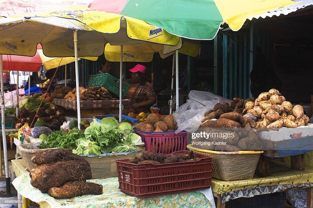 dominica roseau market scene with taro sweet potato yam