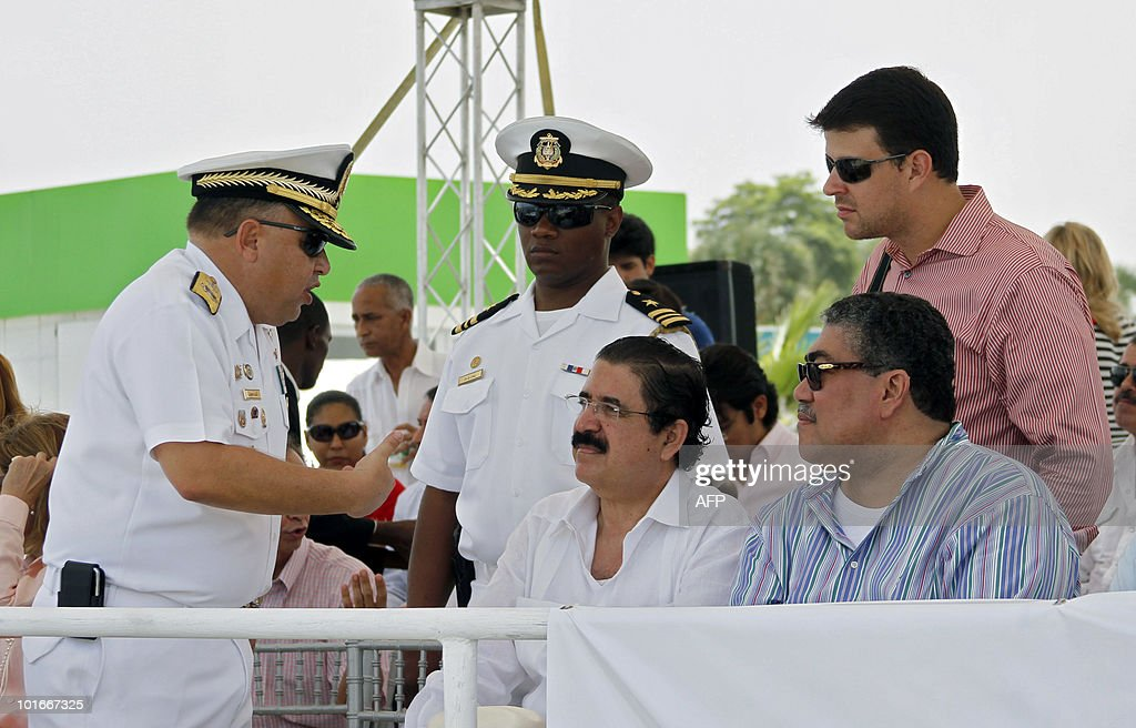 Dominican Chief of Staff Luis Lajara Sola (L) speaks with Honduran former President Manuel Zelaya (C) at Don Diego port in Santo Domingo on June 6, 2010. The international event, which upon reaching this port is dubbed 'Santo Domingo Sails 2010', has ships travelling all around Latin America to celebrate the bicentenary of many of the continent's nations. AFP PHOTO/Erika Santelices