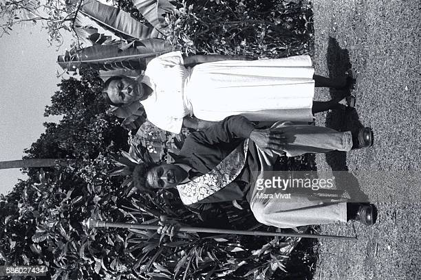 Dominican Couple Man Sitting With Sash and Staff
