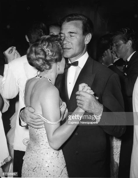 Dominican diplomat and socialite Porfirio Rubirosa holds onto Athina Mary Livanos the wife of Aristotle Onassis as the pair dance very closely at the...