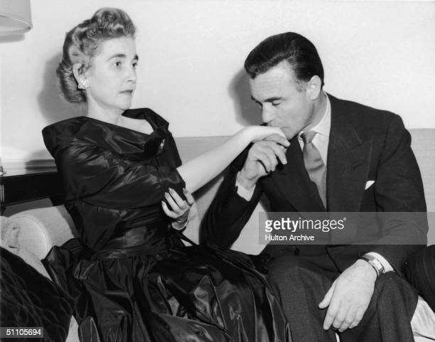 Dominican diplomat and socialite Porfirio Rubirosa kisses tha hand of American socialite and Woolworth's heiress Barbara Hutton at their wedding...