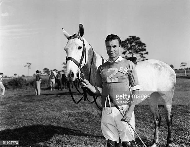 Dominican diplomat and socialite Porfirio Rubirosa poses with his polo pony Palm Beach Florida December 11 1955