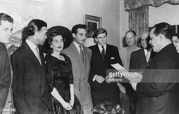 Dominican diplomat and socialite Porfirio Rubirosa stands next to American socialite and Woolworth's heiress Barbara Hutton during their wedding...