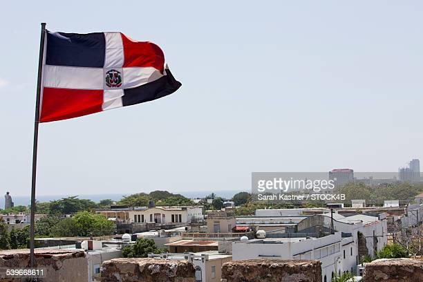 Dominican flag above Santo Domingo, Dominican Republic
