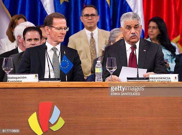 Dominican Foreign Minister Miguel Vargas Maldonado delivers a speech next to the European Union's Director for the Americas Ronald Schaefer during...