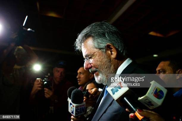 Dominican former Minister of Public Works Victor Diaz Rua, talks to the press after being questioned during six hours on contracts signed during his...