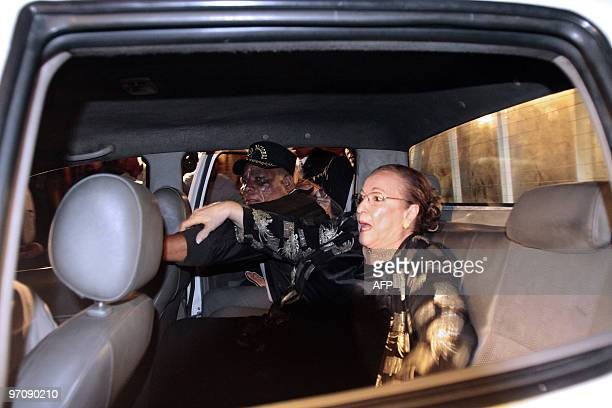 Dominican Julieta Trujillo niece of late Dominican Republic dictator Rafael Trujillo is escorted by police officers as she leaves a hotel in Santo...