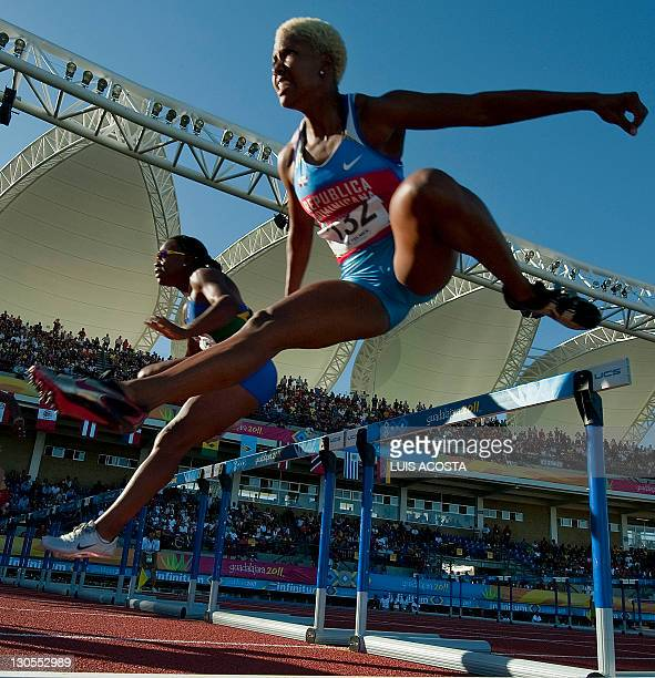 Dominican Lavonne Celeste and Brazilian Maila Machado compete in the Women's 100m Hurdles final at the Guadalajara 2011 XVI Pan American Games in...