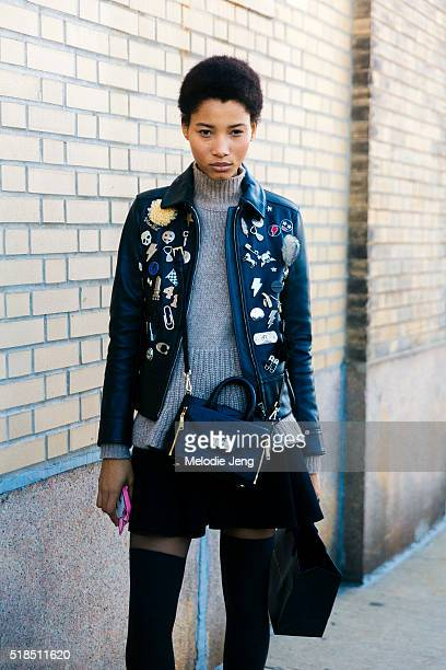 Dominican model Lineisy Montero wears a black Coach embellished racer leather jacket with pins a gray sweater and small Diane Von Furstenberg Secret...