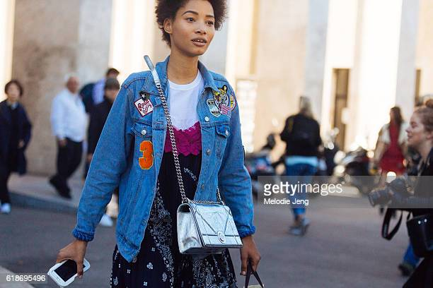 Dominican model Lineisy Montero wears a denim patchwork jacket a dress over a tshirt and a silver Dior purse after the Sacai show at Palais de Tokyo...