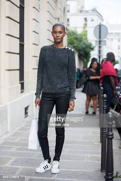 Dominican model Ysaunny Brito wears Adidas superstar sneakers after the Balmain Homme show at Hotel Potocki on June 25 2016 in Paris France