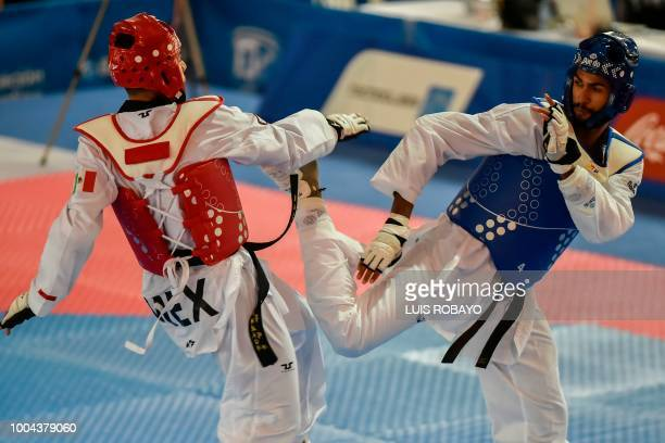Dominican Moises Hernandez competes with Mexican Uriel Adriano in the men's taekwondo under 80 kg category event final during the 2018 Central...