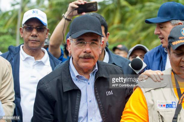 Dominican President Danilo Medina arrives to the community of Boba in the northeast of the Dominican Republic after the passage of Hurricane Maria on...