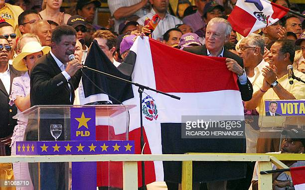 Dominican presidential candidate President Leonel Fernandez and his running mate current VicePresident Rafael Alburquerque display a Dominican flag...