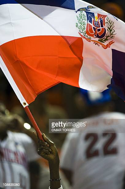 A Dominican Reppublic supporter rises his national flag prior the Caribbean Baseball Series game between Dominican Republic and Puerto Rico at the...