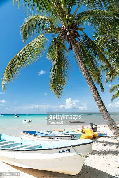 Dominican Republic, boats on the sandy beach of Bayahibe