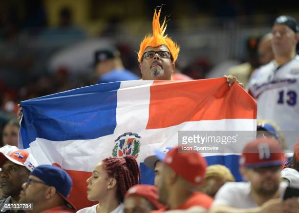 Dominican Republic fans wave their flag during the first round pool C World Baseball Classic game between the Dominican Republic and the United...