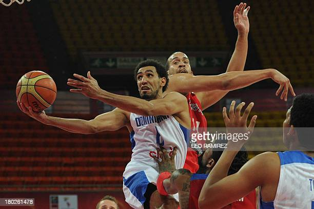 Dominican Republic Juan Coronado tries to score past Puerto Rican Ricardo Sanchez during their FIBA Championship game held in Caracas on September...