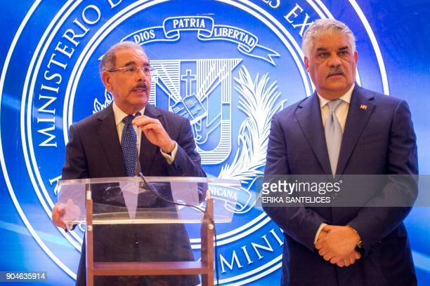 Dominican Republic President Danilo Medina and Foreign Minister Miguel Vargas give a press conference after a meeting between Venezuelan government...