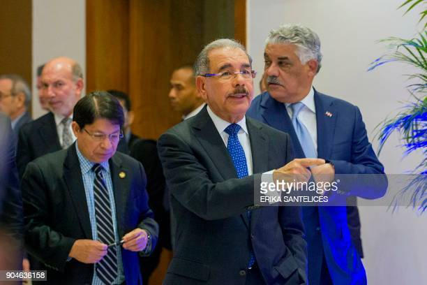 Dominican Republic President Danilo Medina Foreign Minister Miguel Vargas and Nicaraguan Foreign Minister Denis Moncada arrive for a press conference...
