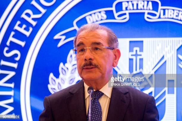 Dominican Republic President Danilo Medina gives a press conference after a meeting between Venezuelan government representatives and members of the...
