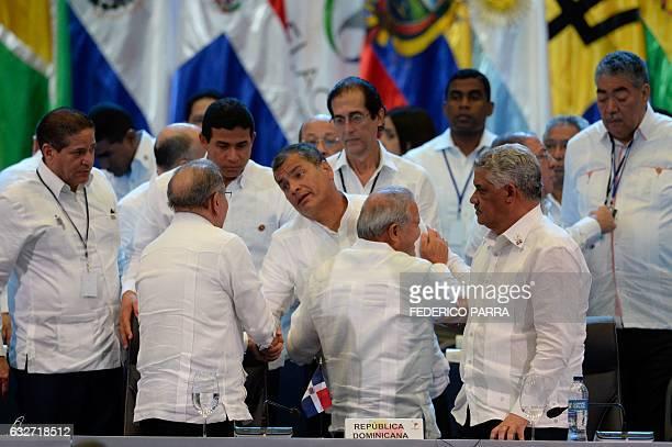 Dominican Republic President Danilo Medina shakes hand with Ecuadorean President Rafael Correa next to Salvadoran President Salvador Sanchez Ceren...
