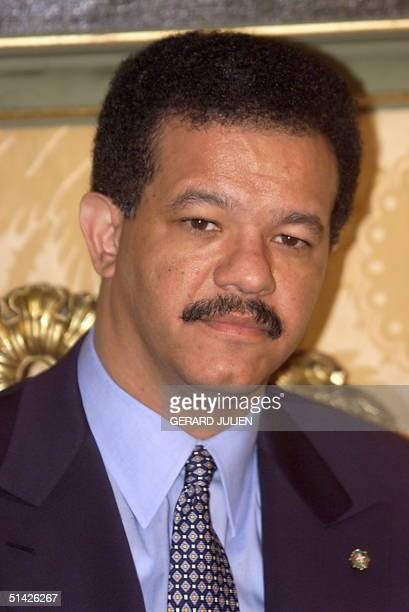 Dominican Republic President Leonel Fernandez poses for photograhers before a meeting with his Italian counterpart Oscar Luigi Scalforo 19 January in...
