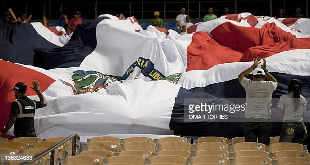 Dominican Republic supporters unfold a giant national flag prior to the start of the Carribbean Series baseball game between Dominican Leones del...