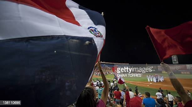 Dominican Republic supporters wave their national flag during the opening ceremony of the Caribbean Series at the Quisqueya stadium in Santo Domingo...