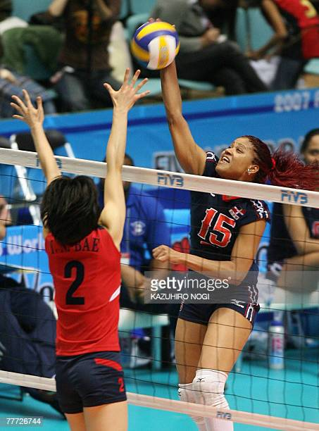 Dominican Republic's captain Cosiri Rodrigues Andino spikes the ball against South Korean blocker Bae Yoo-Na during their second round match of the...