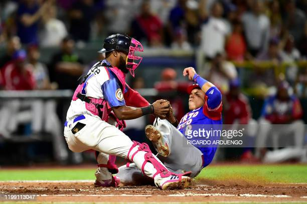 Dominican Republic's catcher Wilkin Castillo tags out at the home plate Puerto Rico's Jan Hernandez during the Caribbean Series baseball tournament...