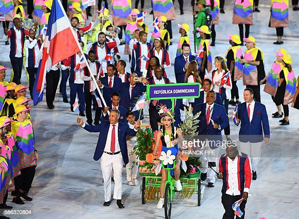 Dominican Republic's flag bearer Luguelin Santos leads his national delegation during the opening ceremony of the Rio 2016 Olympic Games at the...