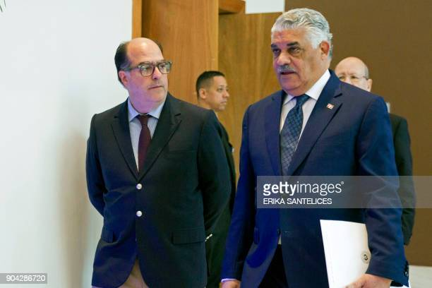 Dominican Republic's Foreign Relations Minister Miguel Vargas Maldonado and Venezuelan opposition representative Julio Borges are pictured before a...