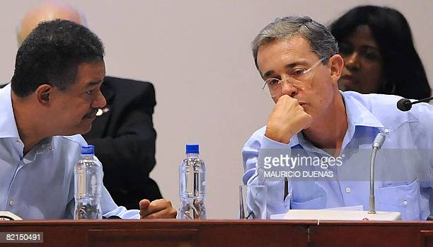 Dominican Republic's President Leonel Fernandez speaks with his Colombian counterpart Alvaro Uribe during the summit on drugs and security on August...