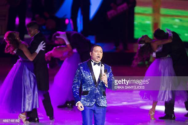 Dominican singer Frank Reyes performs during the XXXI edition of the Soberano Awards in Santo Domingo Dominican Republic April 15 2014 AFP PHOTO /...
