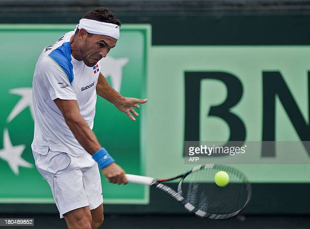 Dominican Victor Estrella returns the ball to Chilean Christian Garin during their Davis Cup match in Santo Domingo on September 13 2013 AFP...