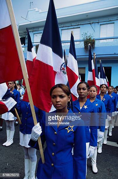 dominican women with national flags - dominican republic flag stock pictures, royalty-free photos & images