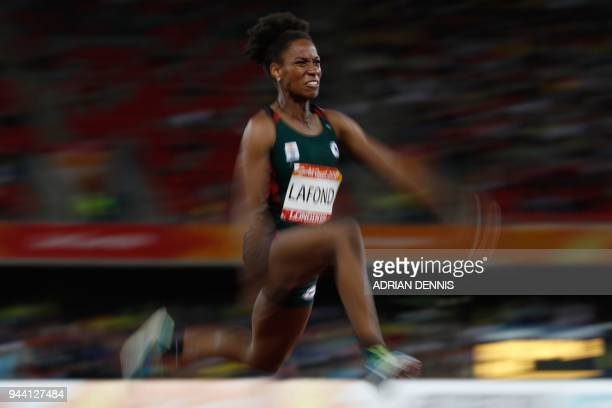 Dominica's Thea Lafond competes in the athletics women's triple jump final during the 2018 Gold Coast Commonwealth Games at the Carrara Stadium on...