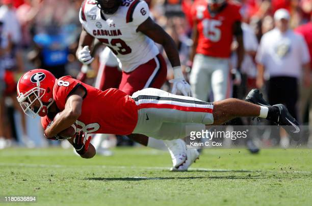 Dominick Blaylock of the Georgia Bulldogs dives for more yardage against the South Carolina Gamecocks in the first half at Sanford Stadium on October...