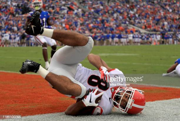 Dominick Blaylock of the Georgia Bulldogs scores a touchdown during a game against the Florida Gators on November 02 2019 in Jacksonville Florida