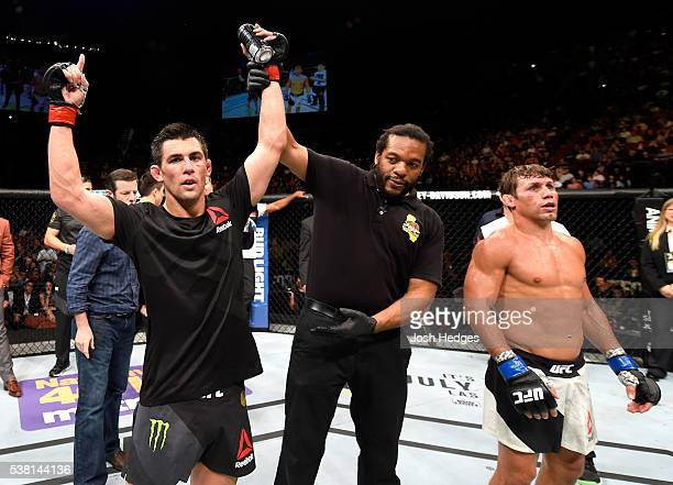 Dominick Cruz celebrates after defeating Urijah Faber by unanimous decision in their UFC bantamweight championship bout during the UFC 199 event at...