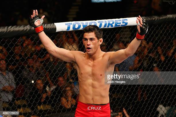 Dominick Cruz celebrates after his victory over Takeya Mizugaki in their bantamweight fight during the UFC 178 event inside the MGM Grand Garden...