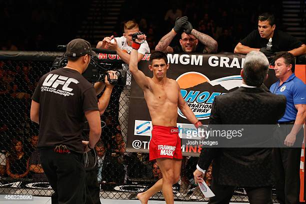 Dominick Cruz enters the Octagon in his bantamweight fight against Takeya Mizugaki during the UFC 178 event inside the MGM Grand Garden Arena on...