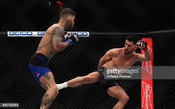 Dominick Cruz kicks Cody Garbrandt in their UFC bantamweight championship bout during the UFC 207 event on December 30 2016 in Las Vegas Nevada