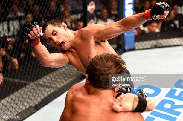 Dominick Cruz kicks Urijah Faber in their UFC bantamweight championship bout during the UFC 199 event at The Forum on June 4 2016 in Inglewood...