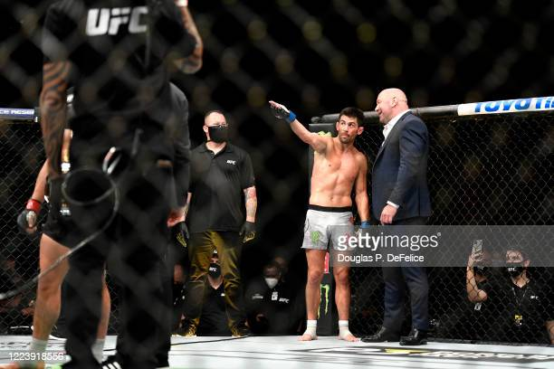 Dominick Cruz of the United States argues with UFC President Dana White after being defeated by Henry Cejudo of the United States in their...