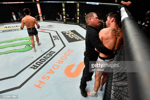 Dominick Cruz protests the stoppage after his TKO loss to Henry Cejudo in their UFC bantamweight championship fight during the UFC 249 event at...
