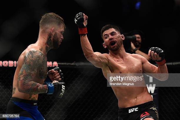 Dominick Cruz punches Cody Garbrandt during the UFC 207 event at TMobile Arena on December 30 2016 in Las Vegas Nevada