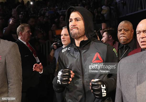 Dominick Cruz walks to the Octagon to face Cody Garbrandt in their UFC bantamweight championship bout during the UFC 207 event on December 30 2016 in...
