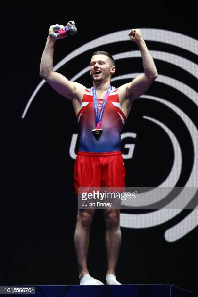 Dominick Cunningham of Great Britaincelebrates at the podium with his gold medal after winning the Floor Exercise Men's Gymnastics Final on Day...